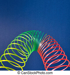 Geometric parabola from colored slinky toy. - Flexible ...