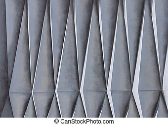 Geometric texture on the facade of the house. Triangular shapes