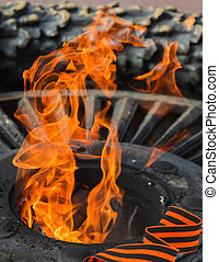George Ribbon on a background of quenchless flame dedicated to victory World War II