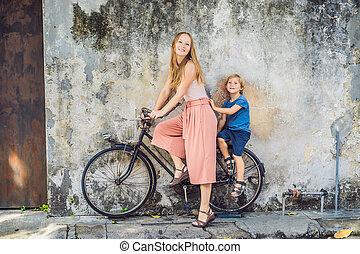 Georgetown, Penang, Malaysia - April 20, 2018: Mother and ...