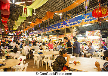 GEORGETOWN, PENANG, MALAYSIA-AUGUST 9, 2015 a lot of people in food center at george town, Penang, Malaysia