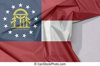 Georgia fabric flag crepe and crease with white space, The states of America, red white red, blue canton containing a ring of stars encompassing the coat of arms in gold.