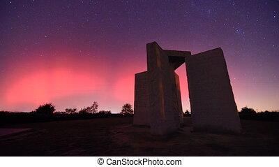 Georgia Guidestones - Aurora borealis appears behind the...