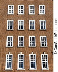 Detail of windows on the brick exterior of a Georgian-style property in Central London, UK