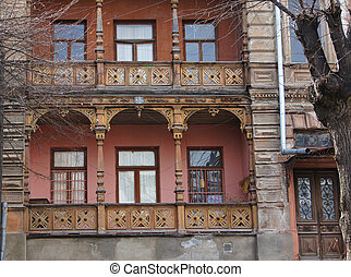 Traditional georgian architecture: wooden balconies and stone carvings