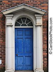 Georgian door - Birmingham. Old brick building and blue...