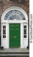Georgian doorway in Dublin, Ireland, with cast iron fanlight...