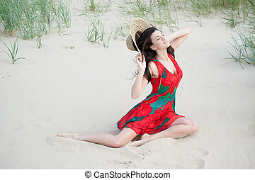 Georgian girl on the beach - sweet girl in a red dress lying...