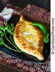 georgian khachapuri with its white sauce