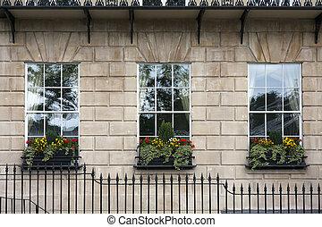 Georgian window triptych. Detail of windows with windowboxes...