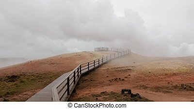 Steaming vents at Gunnuhver geothermal area in Iceland, hot pit