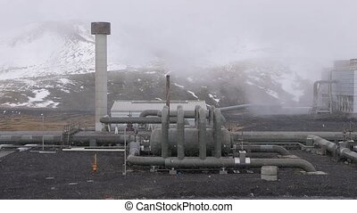 Geothermal power plant in Iceland, pipe stuctures and...