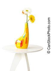Gerbera Flowers Vase on White Table.
