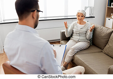 senior woman patient talking to psychologist
