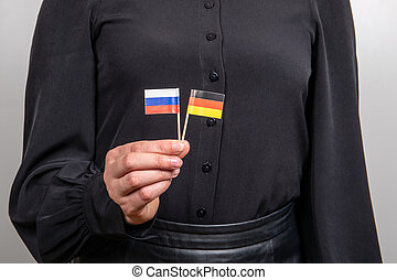 German and Russian flags. Economic and political relations. ...