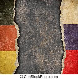 German and Russian torn paper flags. Break of diplomatic relations.