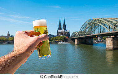 German beer (Kölsch) at Cologne at the rhine river Germany -...