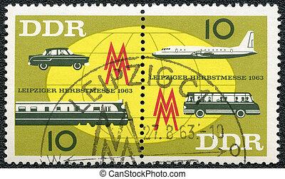 GERMAN DEMOCRATIC REPUBLIC - 1963: shows Globe, plane and bus, car and train