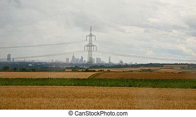 german fields with frankfurt skyline