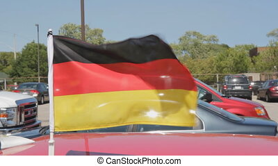 German FIFA flag on car. 2 shots. - Flag of Germany on a...