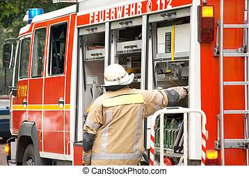 german firefighter - german fire fighter with a fire engine
