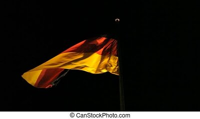 German flag blows on the wind at night - Sinister flag of...
