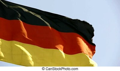 German flag is fluttering in wind.