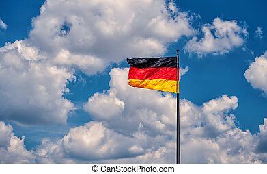 German flag on a background of the sky