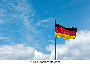 German flag on blue sky