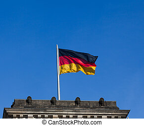 German flag on the top of Reichstag building, Berlin, Germany