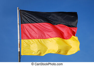 german flag waving in the wind in front of deep blue sky