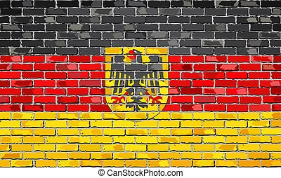 German flag with emblem on a brick