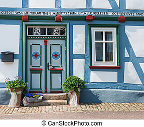 Door and window traditional half-timbered house close-up. Germany