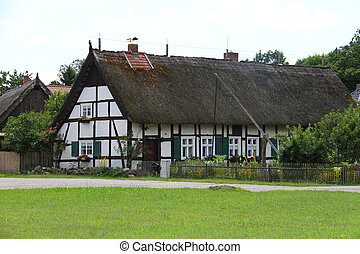 German house with hay roof on the loan