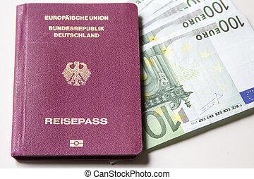 German international traveling passport and euro money. - ...