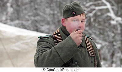 German machine gunner smokes a pipe sequence