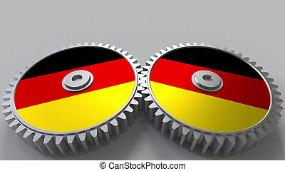 German national project. Flags of Germany on moving cogwheels. Conceptual 3D rendering