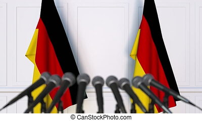 German official press conference. Flags of Germany and...