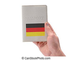 German passport in a man's hand on white background. Travel ...