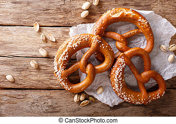 German pretzels with salt close-up on the table. horizontal top view