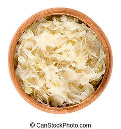 German sauerkraut in wooden bowl over white