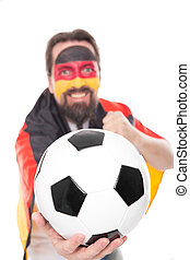 German soccer fan is cheering, Football in the front