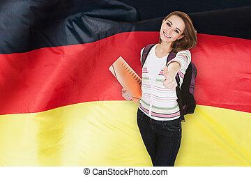 German Student Gesturing Thumb Up