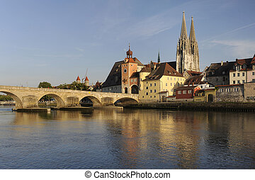 famous historic old town regensburg in germany with stone bridge over river danube
