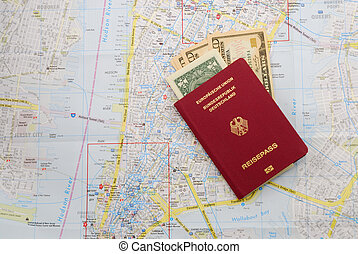 German travel pass with dollar notes over the map of New ...