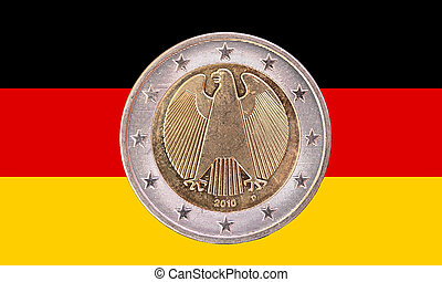 A two euros coin from Germany isolated with the national german flag as background