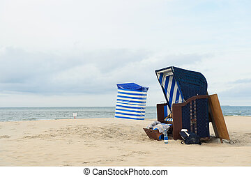 Beach of German wadden island with typical striped chair