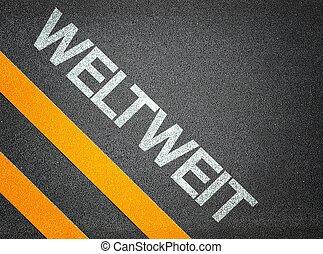 German weltweit - wordlwide - Text Writing Road Asphalt