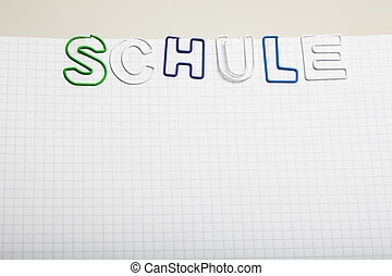 German word Schule - Paper clip letters - German word Schule...