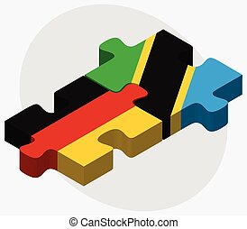 Germany and Tanzania Flags in puzzle isolated on white...